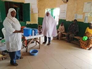 Facility Staff educating women on hand washing and GBV during ANC and postnatal visit at Kanya PHC
